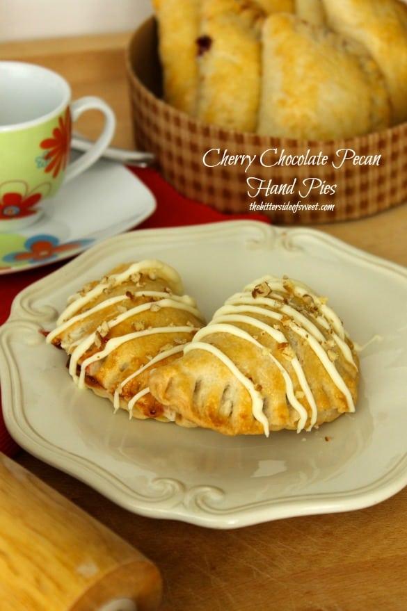 Cherry Chocolate Pecan Hand Pies | thebittersideofsweet.com #piday #dessert