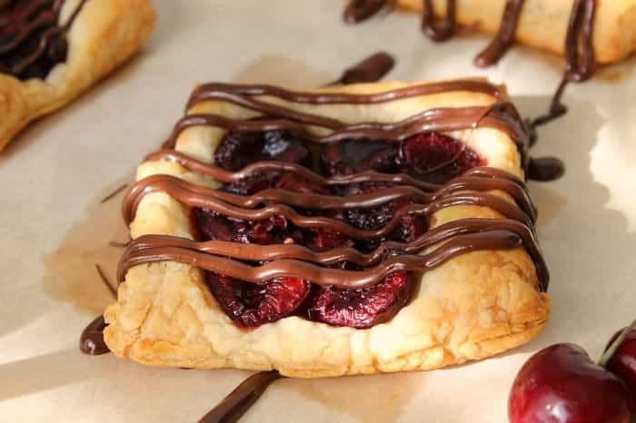 Chocolate Cherry Tarts using fresh cherries, puff pastry and chocolate. Quick to prepare and baked in 15 minutes!