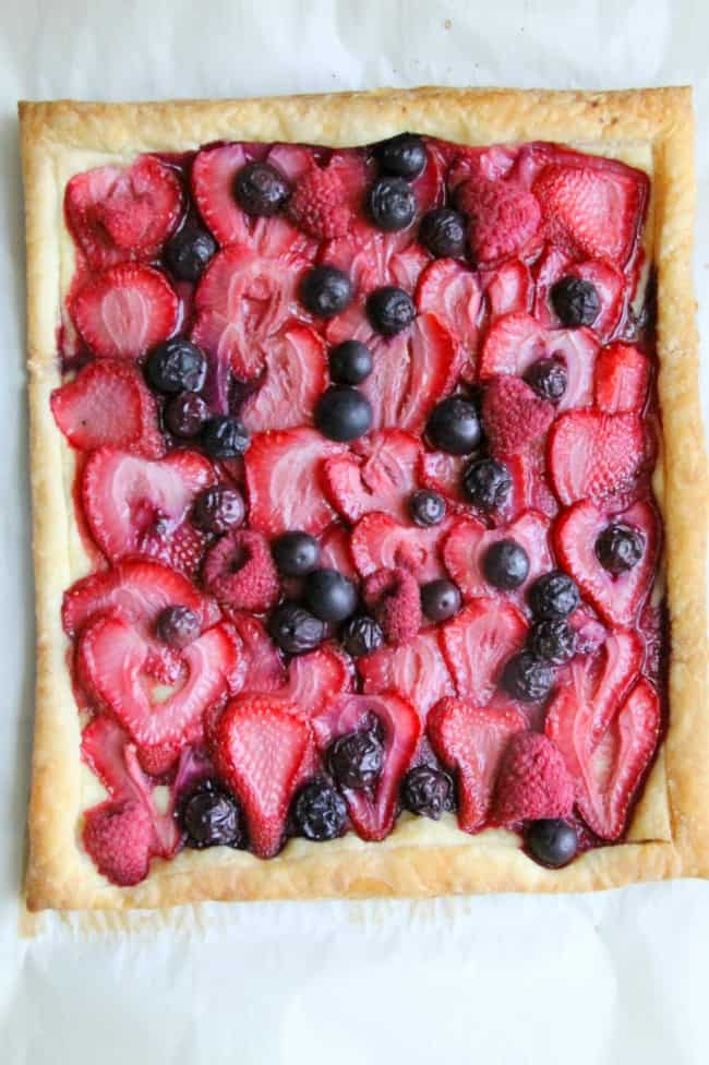Mixed Berry Tart on parchment paper