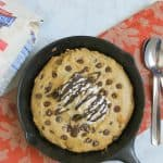 Chocolate Chip Pumpkin Skillet Cookie in skillet on orange napkin