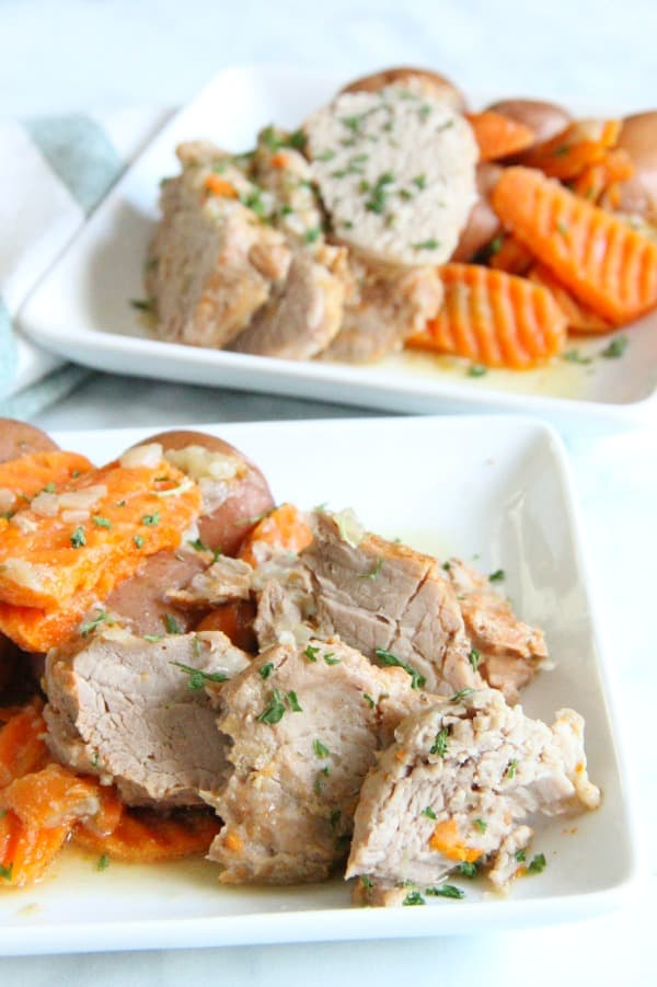 Instant Pot Pork with Potatoes and Carrots on white plate