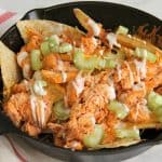 Buffalo Chicken Skillet Nachos in black skillet