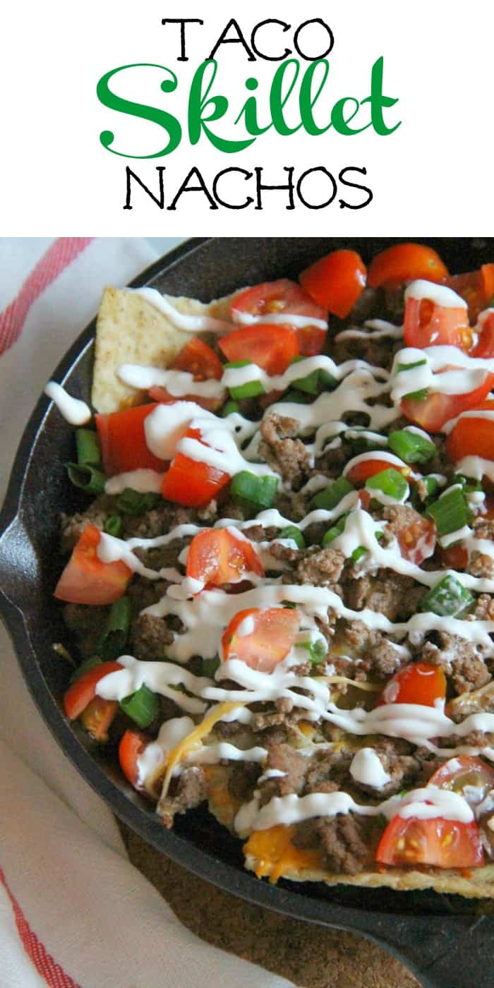 Taco Skillet Nachos are the best kind of party food! All of your favorite flavors for tacos topped onto a bed of tortilla chips for a delicious appetizer! | The Bitter Side of Sweet #gameday #appetizer #taco
