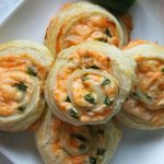 Puff Pastry Jalapeno Popper Pinwheels on white plate