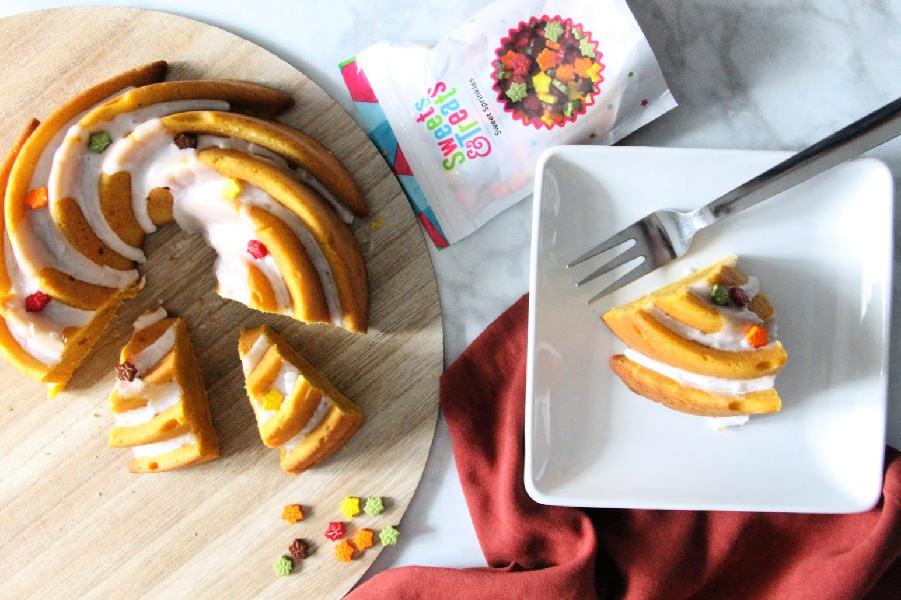 Easy Pumpkin Bundt Cake on brown background