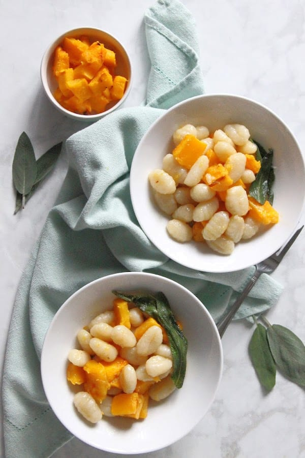 Pumpkin Gnocchi with Sage Butter Sauce in white bowl