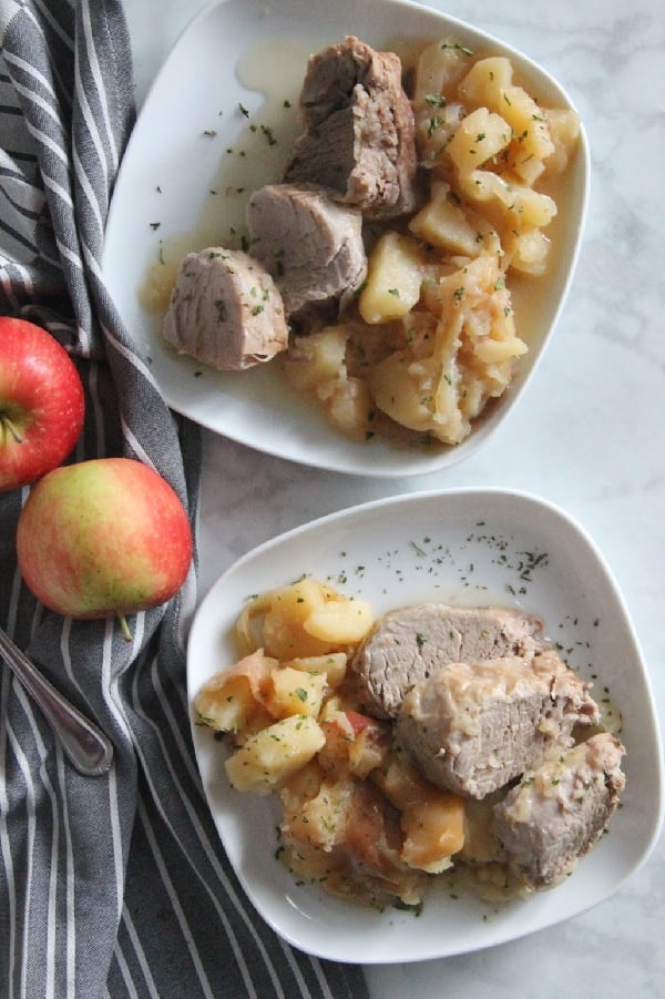 Instant Pot Pork Tenderloin with Apples and Onions on white plate