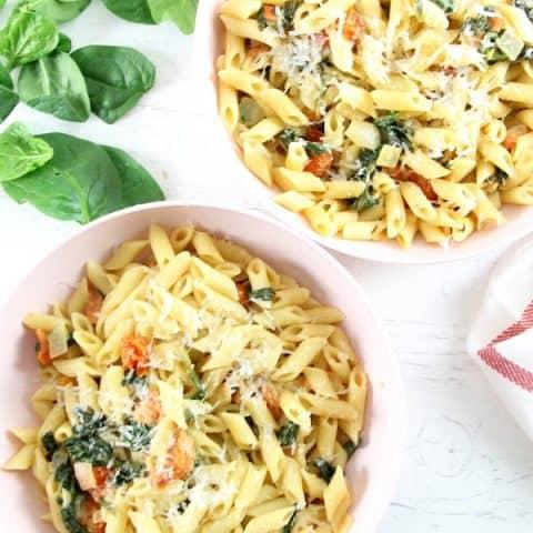 Creamy Tomato Spinach Pasta in bowls