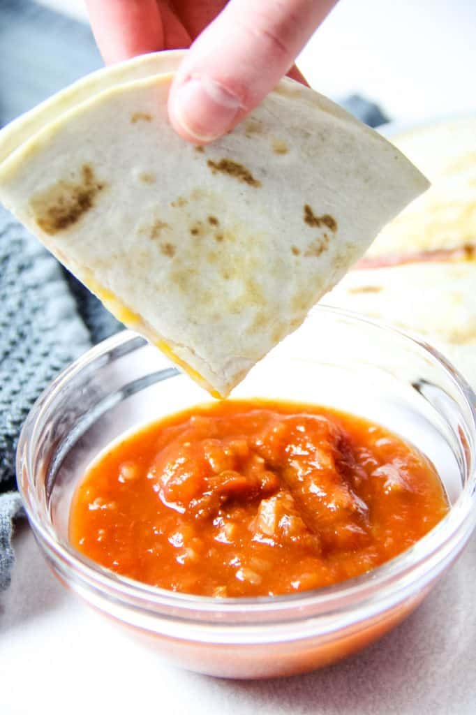 Ham and Cheese Quesadillas dipped in salsa