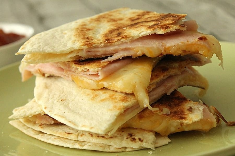 Ham and Cheese Quesadillas stacked on green plate