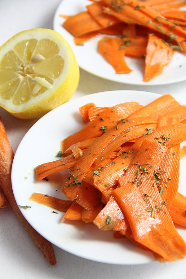 Lemon Carrot Salad on white plate topped with parsley