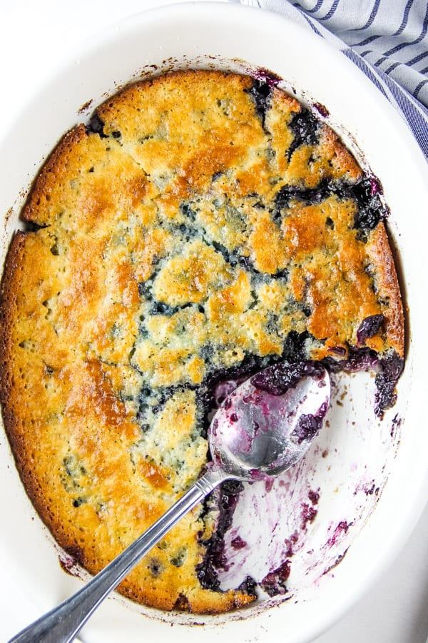 Blueberry Cobbler in white bowl with spoon