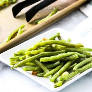 Sheet Pan Roasted Green Beans on white plate