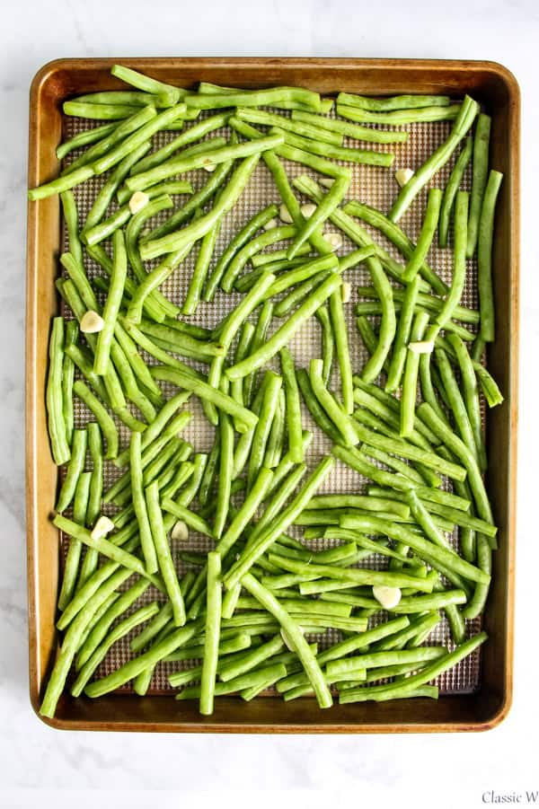 Sheet Pan Roasted Green Beans uncooked on sheet pan