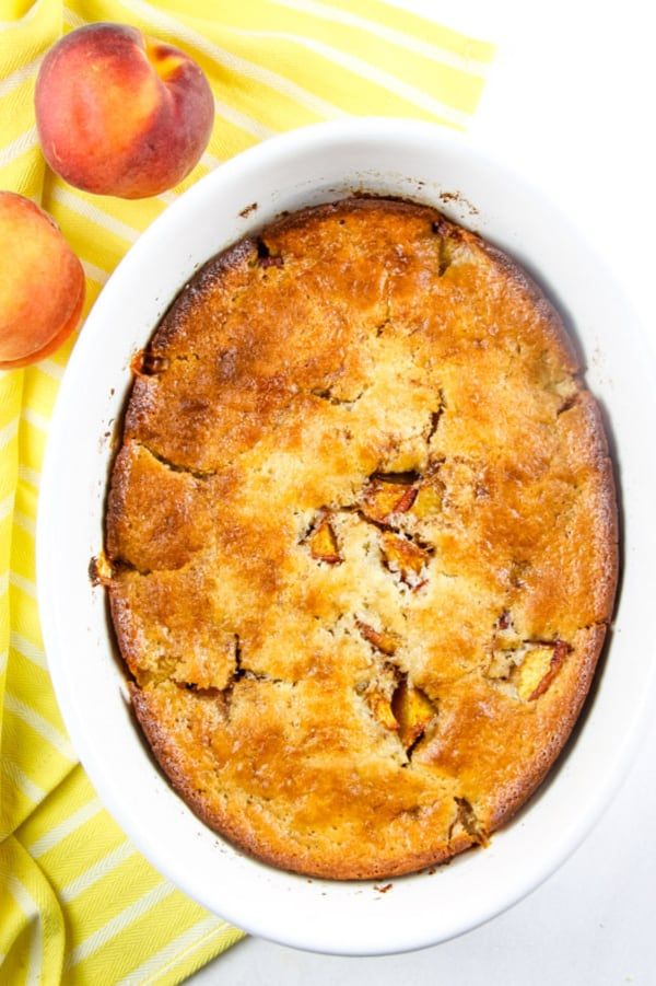 Peach Cobbler in white serving dish