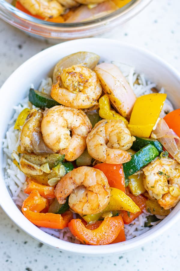 Garlic Thyme Shrimp and Veggies in white bowl with rice