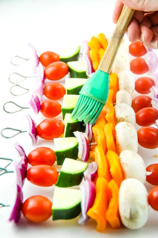 Grilled Vegetable Skewers with green brush, brushing on oil