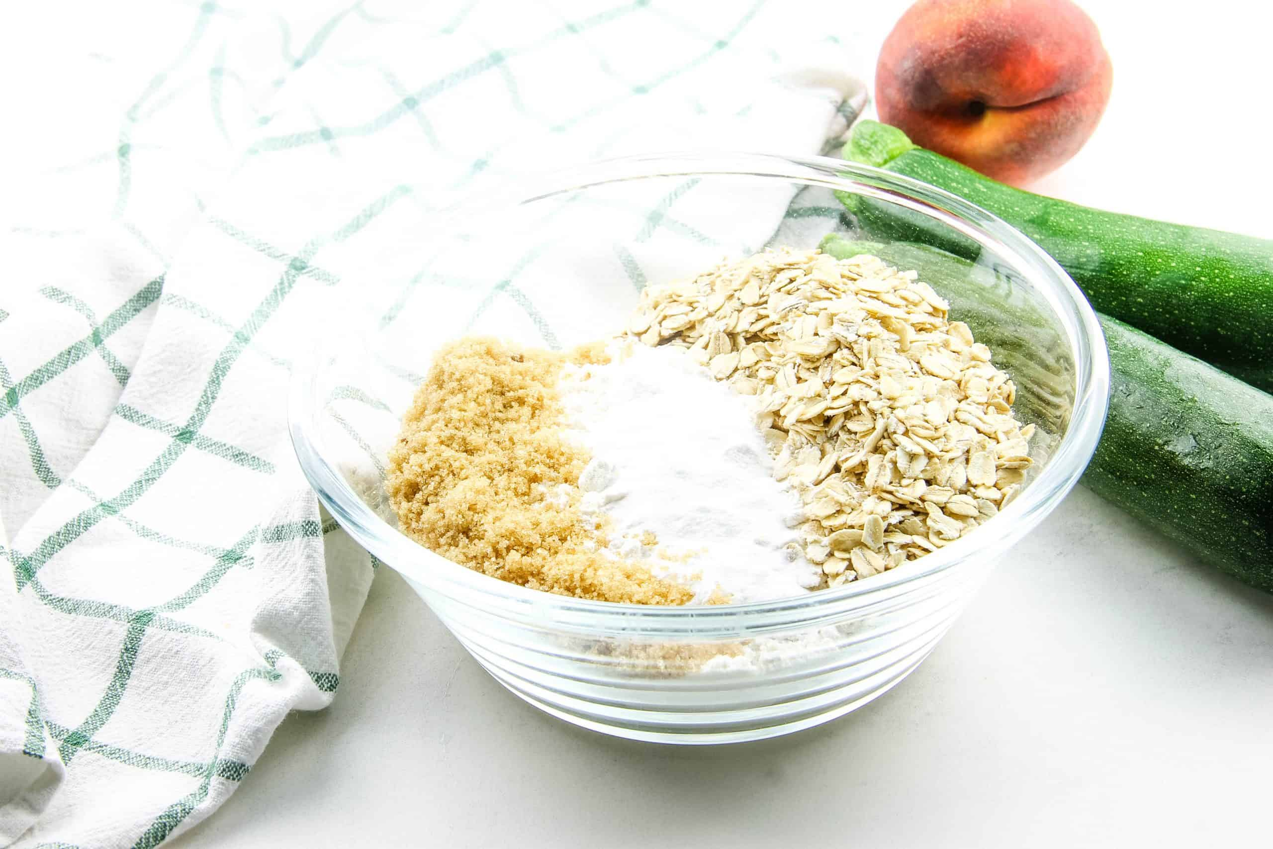 Peach Zucchini Oatmeal Muffins, dry ingredients in glass bowl