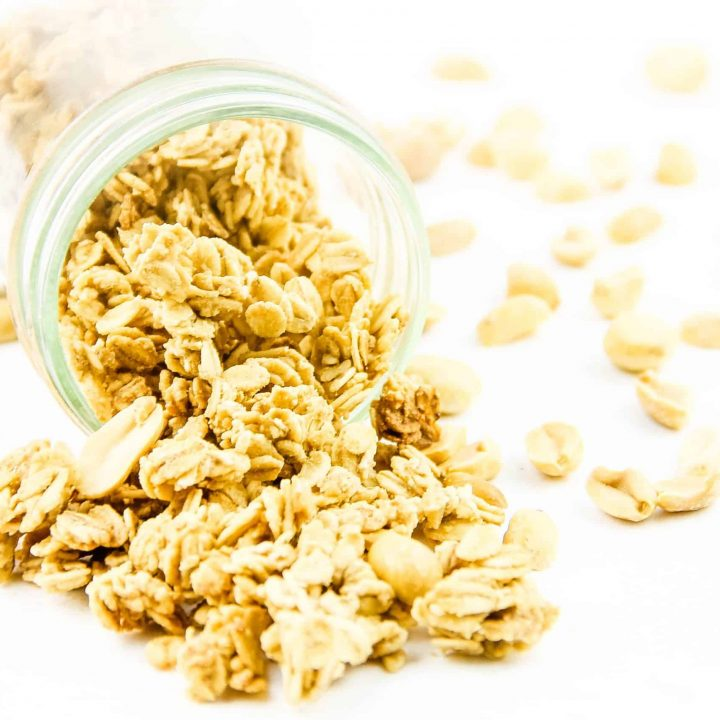 Peanut Butter Granola spilling out of glass jar