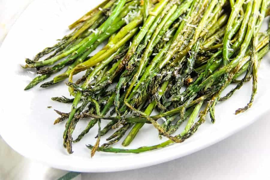 Sheet Pan Roasted Asparagus on white platter