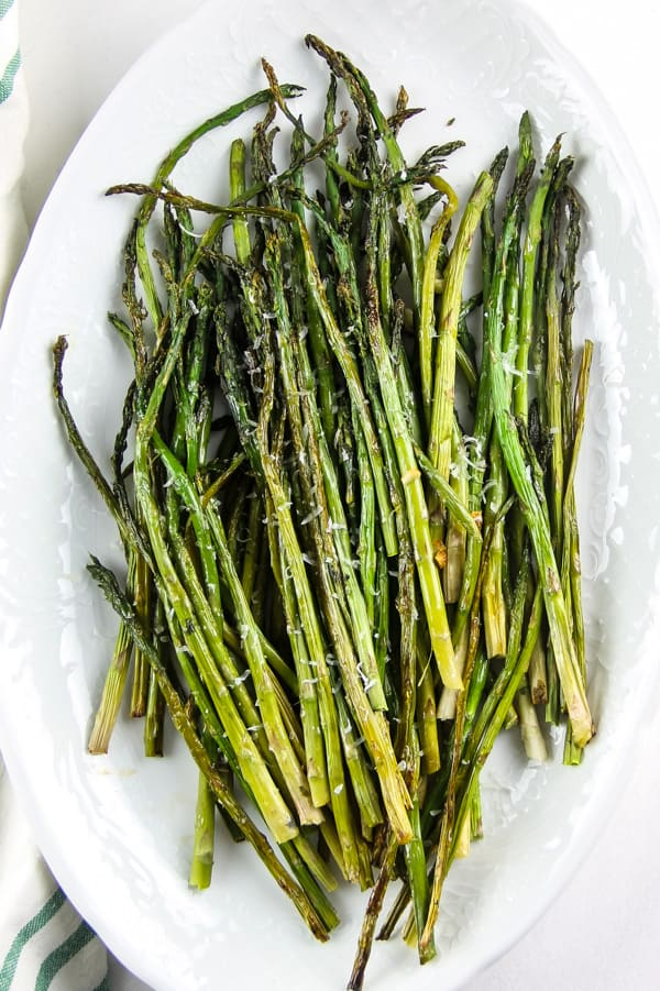 Sheet Pan Roasted Asparagus on white platter