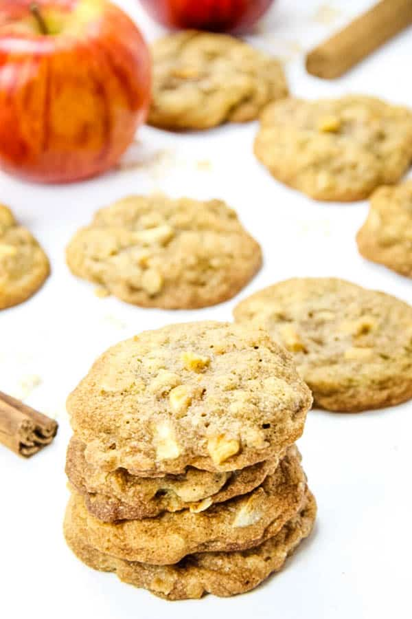Apple Cinnamon Oatmeal Cookies stacked on white background