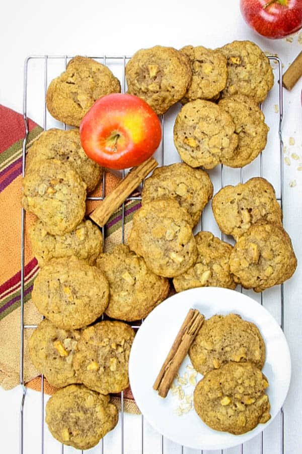 Apple Cinnamon Oatmeal Cookies overhead view with apples and cinnamon sticks