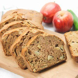 Apple Zucchini Bread sliced on brown cutting board