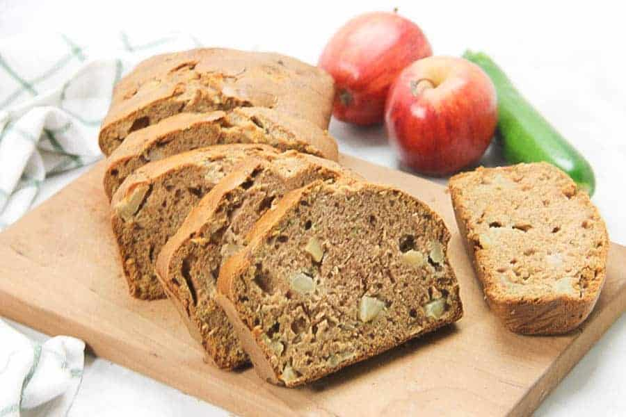 Apple Zucchini Bread sliced on brown cutting board