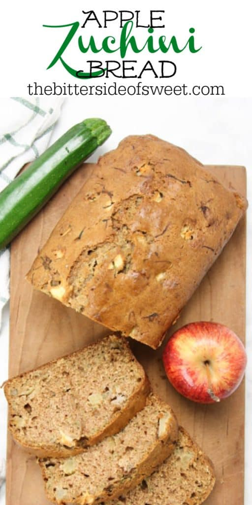 Apple Zucchini Bread on brown cutting board with apple and zucchini