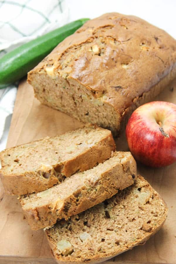 Apple Zucchini Bread on brown cutting board