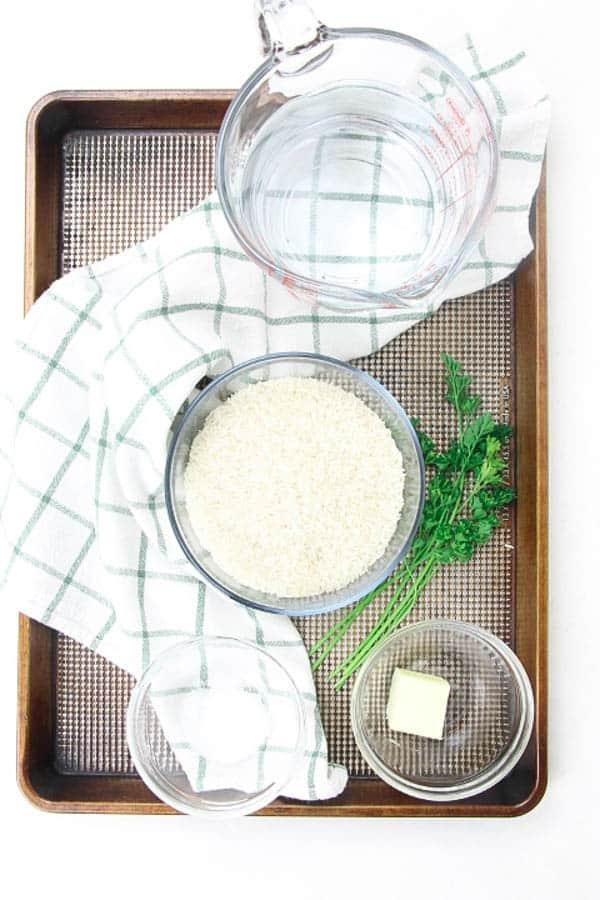 Instant Pot Basmati Rice ingredients on brown cookie sheet