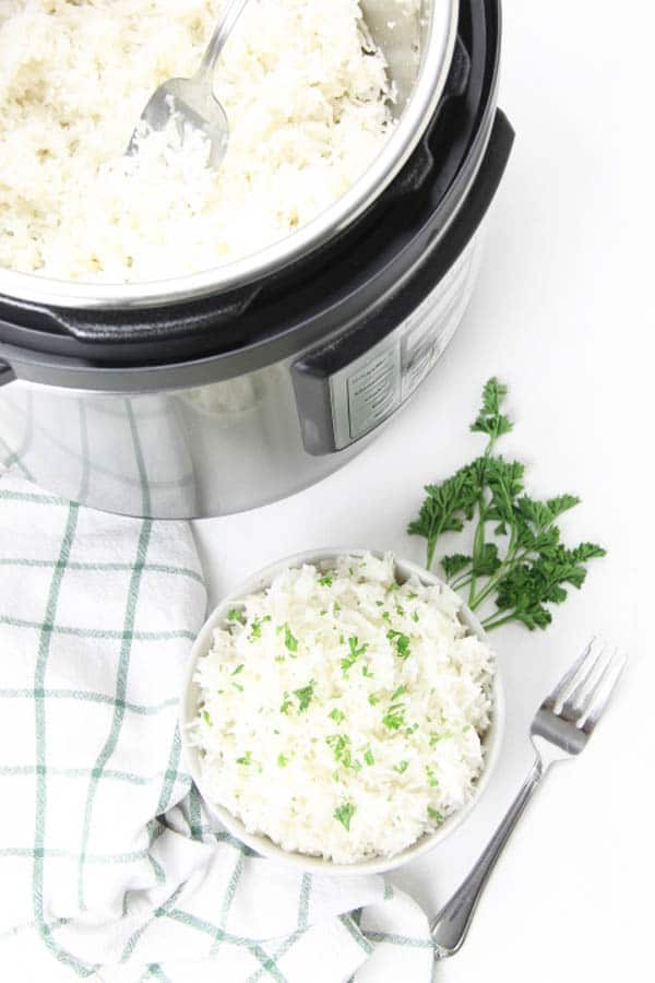Instant Pot Basmati Rice in white bowl with fork