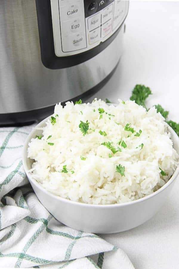 Instant Pot Basmati Rice in white bowl topped with parsley