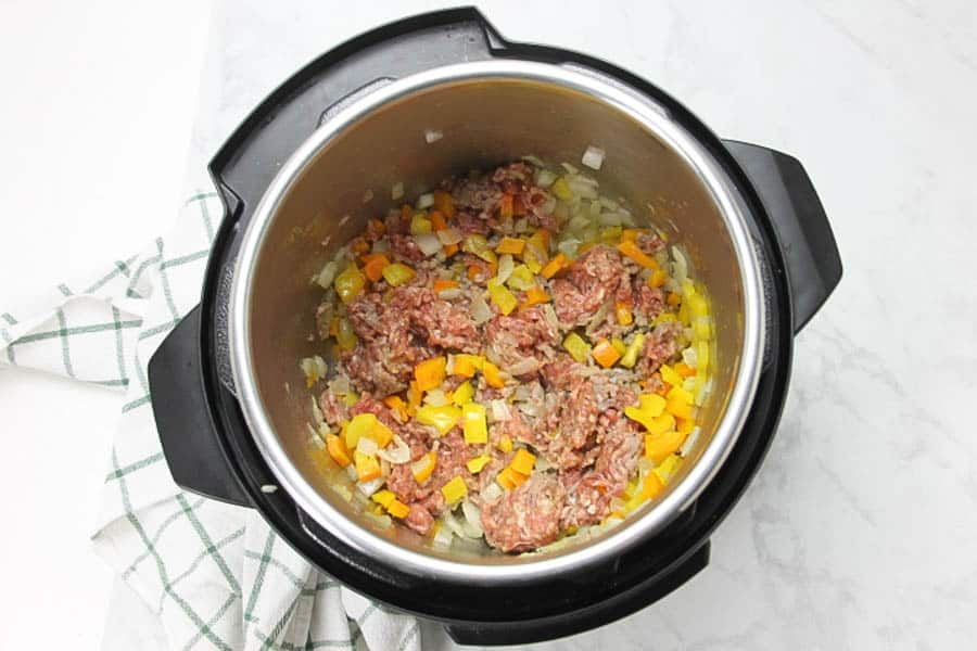 Instant Pot Sausage and Peppers Risotto with sausage in pot
