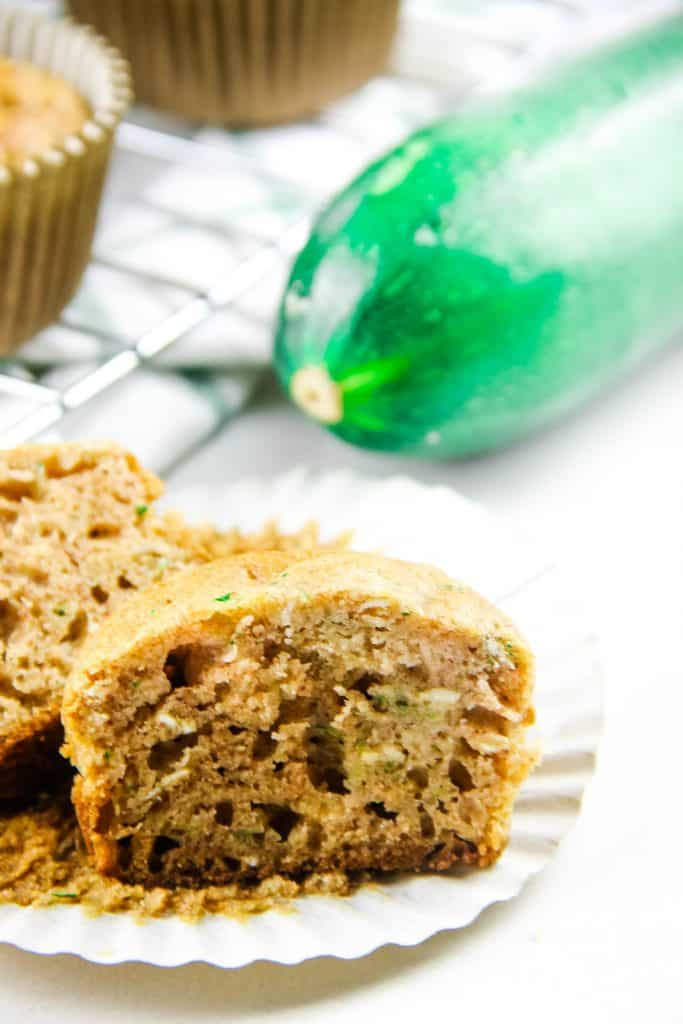 Zucchini Oatmeal Muffins cut open on liner