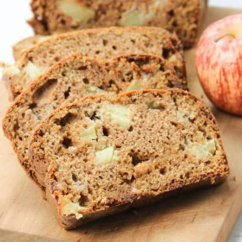 Caramel Apple Bread on brown cutting board in slices