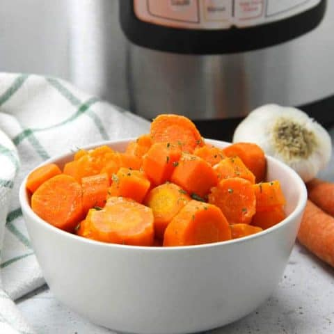 Instant Pot Carrots in gray bowl with green and white napkin