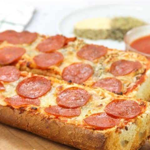 Pepperoni French Bread Pizza cooked on cutting board