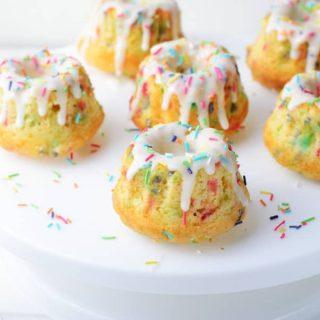 Funfetti Mini Bundt Cakes with 6 cakes on white cake plate