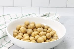 Roasted Rosemary Potatoes uncooked in bowl