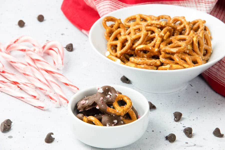 Chocolate dipped pretzels in white bowl