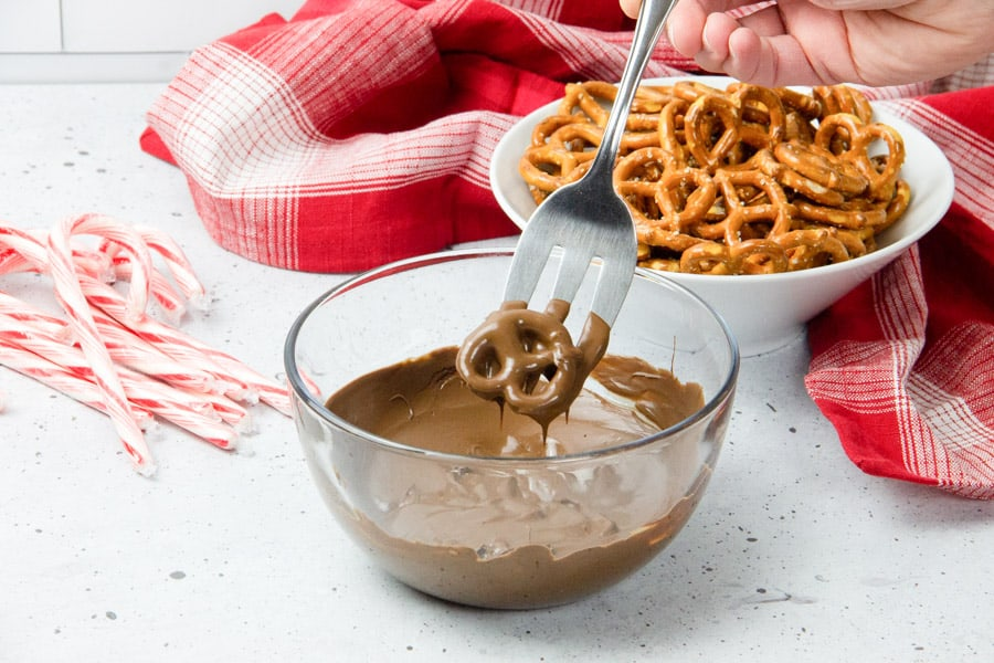 Pretzel dipped in chocolate in glass bowl