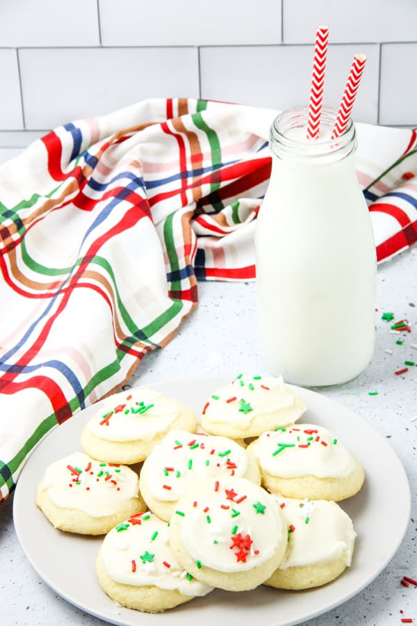 Soft Sugar Cookies on white plate with milk in a jug