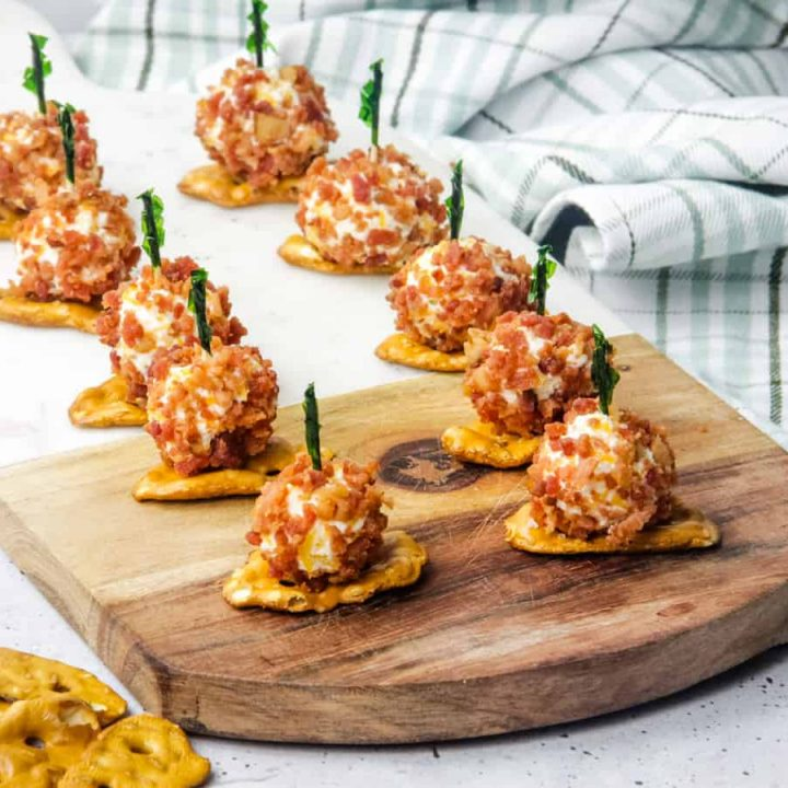 Mini Bacon Ranch Cheeseballs on pretzels with toothpick