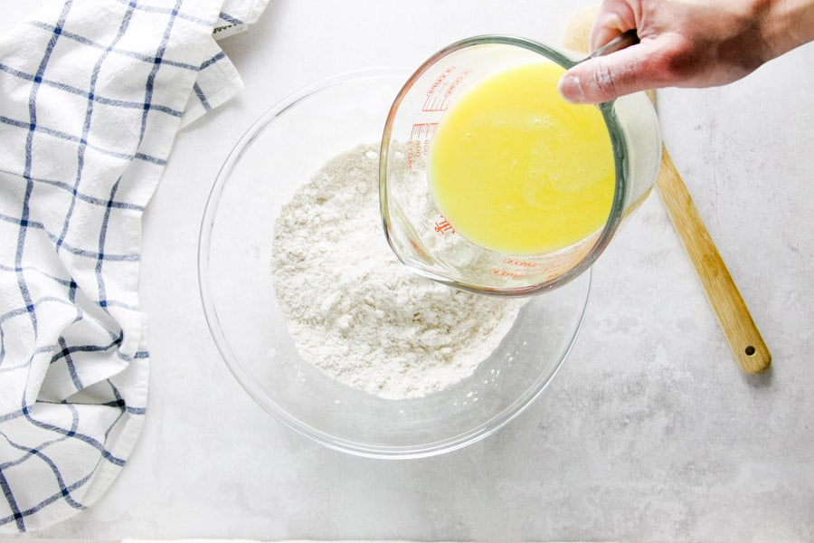 pouring butter mixture in bowl.