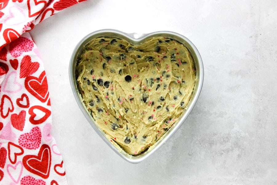 cookie cake uncooked in heart shaped pan