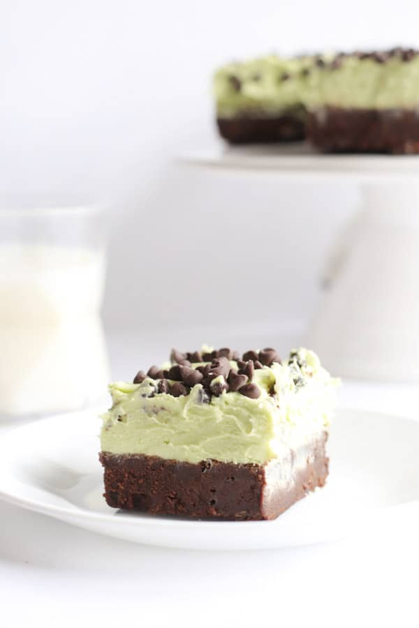 Mint Chocolate Chip Brownies single slice on white plate.