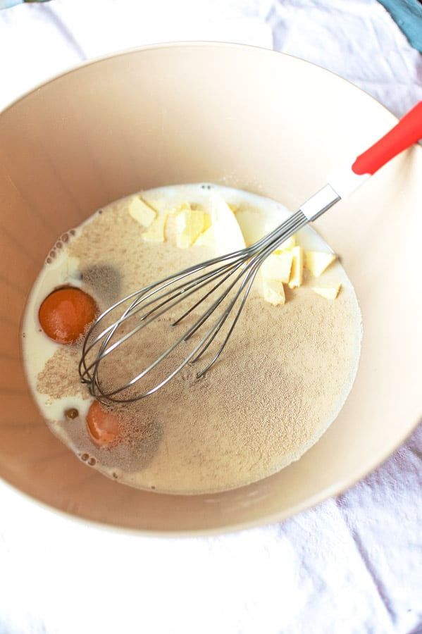 wet ingredients for cinnamon rolls in bowl