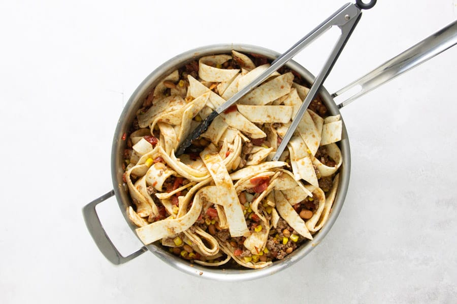 tortilla strips in skillet.
